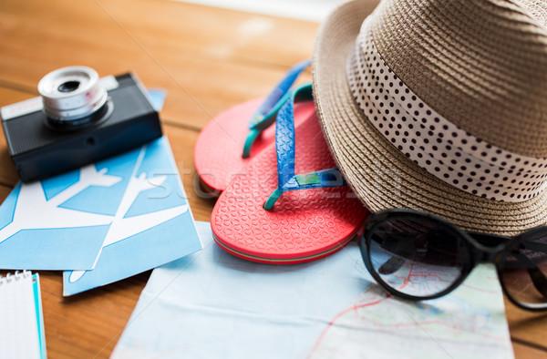 close up of travel map, flip-flops, hat and camera Stock photo © dolgachov