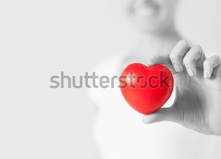 happy woman with small red heart Stock photo © dolgachov
