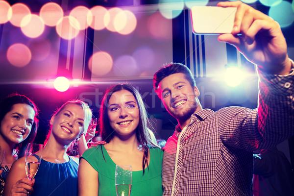 друзей очки смартфон клуба вечеринка праздников Сток-фото © dolgachov