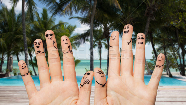 close up of hands and fingers with smiley faces Stock photo © dolgachov