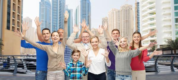 group of smiling people having fun Stock photo © dolgachov