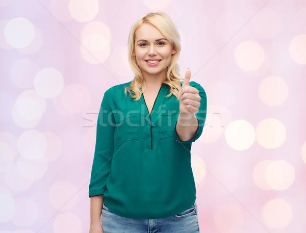Gülen genç kadın gömlek kadın Stok fotoğraf © dolgachov