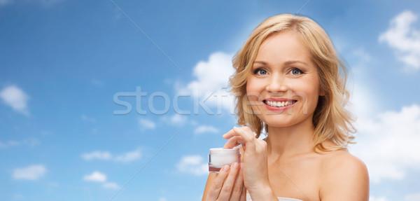 Szczęśliwy kobieta krem jar piękna ludzi Zdjęcia stock © dolgachov