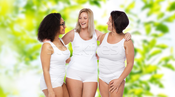 group of happy plus size women in white underwear Stock photo © dolgachov