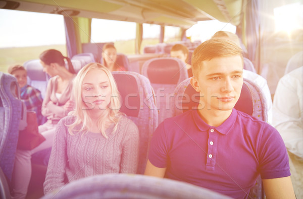 couple or passengers in travel bus Stock photo © dolgachov
