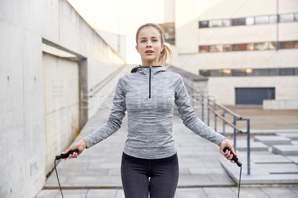 woman exercising with jump-rope outdoors Stock photo © dolgachov