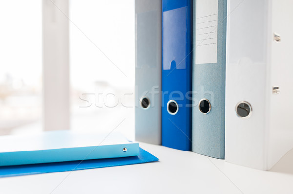 close up of ring binders and files on office table Stock photo © dolgachov