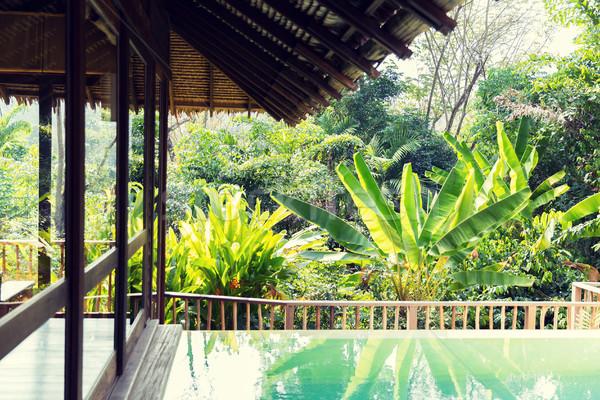 Piscina bangalô hotel recorrer lazer viajar Foto stock © dolgachov