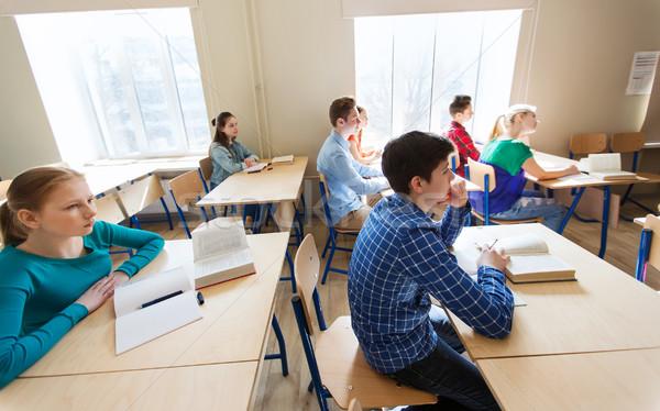 Csoport diákok könyvek iskola lecke oktatás Stock fotó © dolgachov