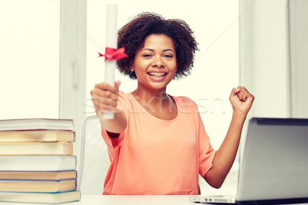 Mutlu Afrika kadın dizüstü bilgisayar kitaplar diploma Stok fotoğraf © dolgachov