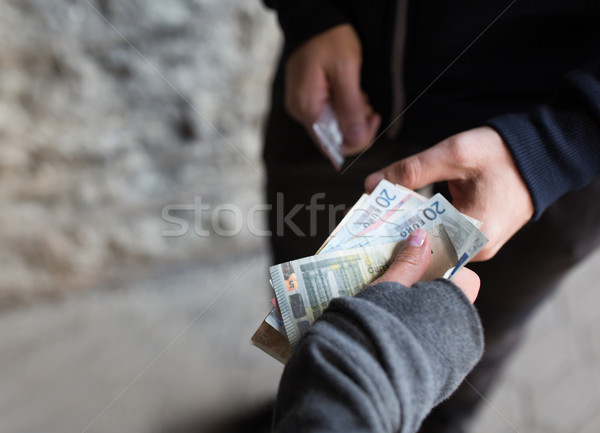 close up of addict buying dose from drug dealer Stock photo © dolgachov