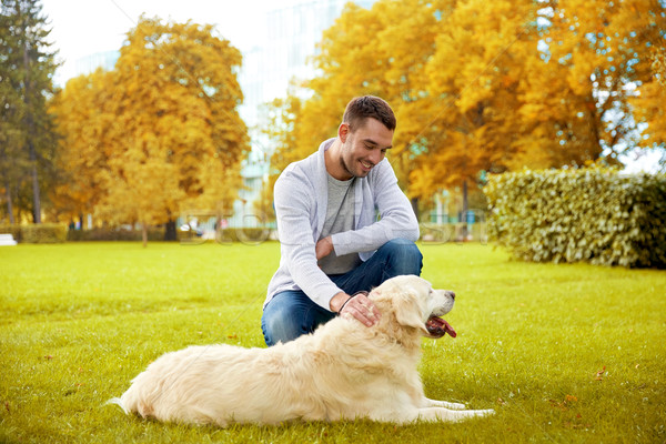 happy man with labrador dog walking in city Stock photo © dolgachov