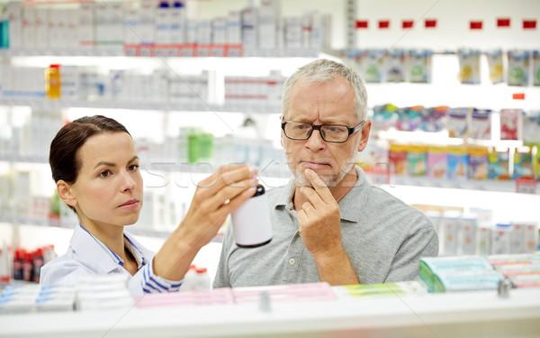 Farmacista droga senior uomo farmacia Foto d'archivio © dolgachov