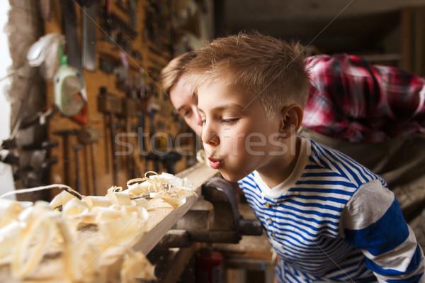 Baba küçük oğul ahşap atölye Stok fotoğraf © dolgachov
