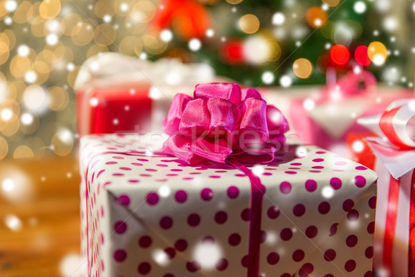 close up of gift boxes over christmas tree lights Stock photo © dolgachov