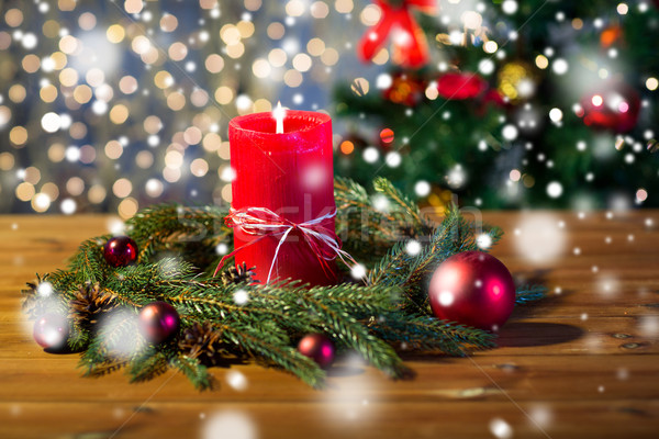 Stock photo: fir branch wreath with candle on wooden table