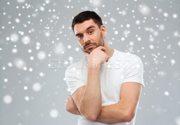 Férfi gondolkodik hó kétség tél karácsony Stock fotó © dolgachov