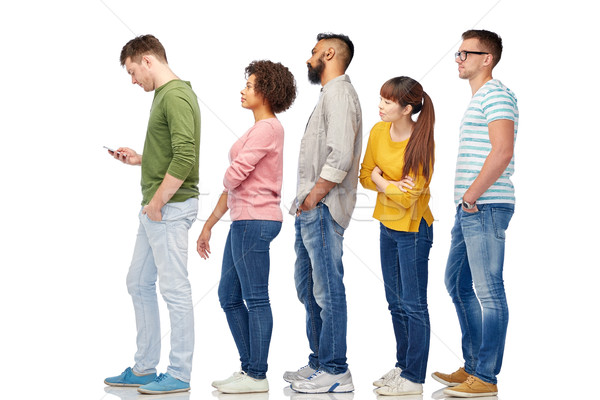 group of people in queue with smartphone Stock photo © dolgachov