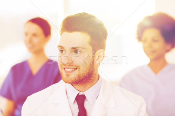 Stock photo: happy doctor over group of medics at hospital