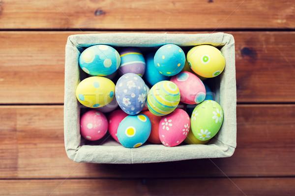 Közelkép színes húsvéti tojások kosár húsvét ünnepek Stock fotó © dolgachov