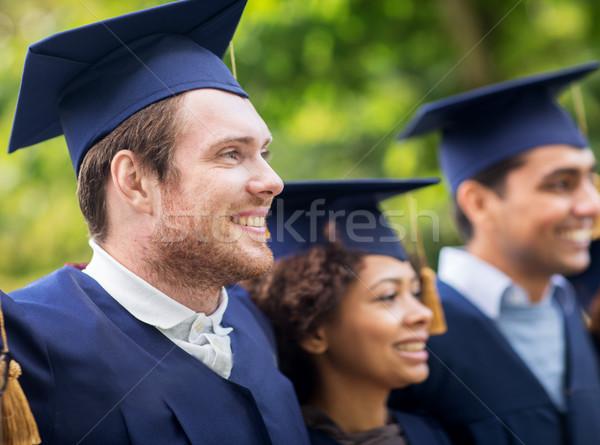 Foto stock: Feliz · estudiantes · solteros · educación · graduación · personas