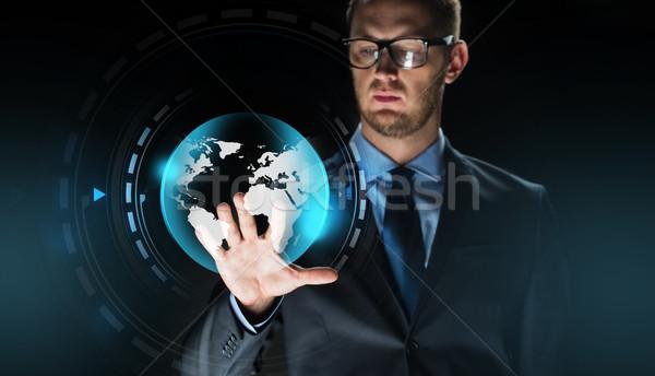 Empresário virtual terra globo projeção pessoas de negócios Foto stock © dolgachov