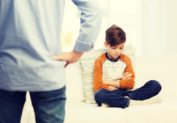 upset or feeling guilty boy and father at home Stock photo © dolgachov