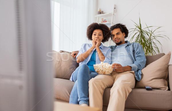 пару попкорн смотрят телевизор домой люди Сток-фото © dolgachov