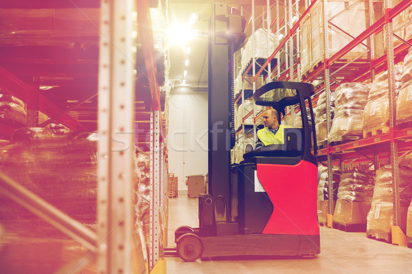 Stock photo: man on forklift loading cargo at warehouse