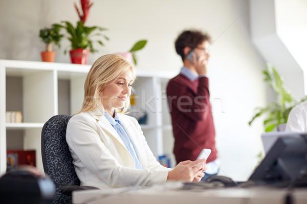 Stock fotó: Boldog · üzletasszony · okostelefonok · iroda · üzlet · vállalati