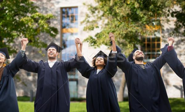 Feliz estudiantes solteros graduación educación Foto stock © dolgachov