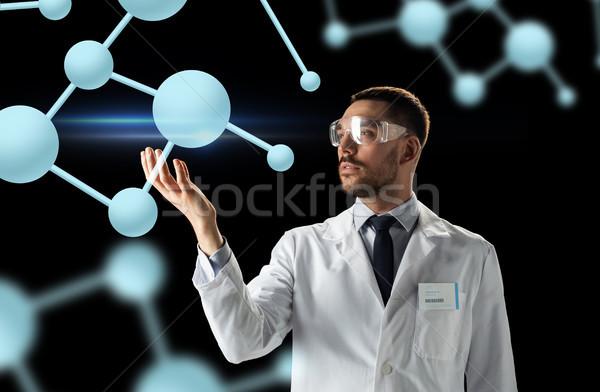 Wetenschapper laboratoriumjas stofbril moleculen wetenschap biologie Stockfoto © dolgachov