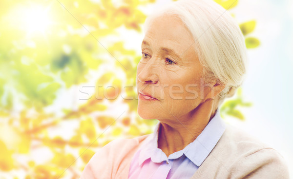 senior woman face over green natural background Stock photo © dolgachov