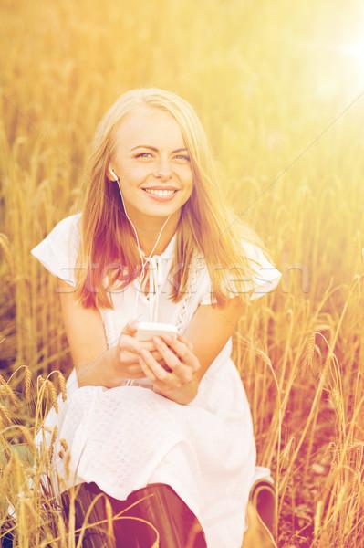 Gelukkig vrouw smartphone zomer vakantie Stockfoto © dolgachov