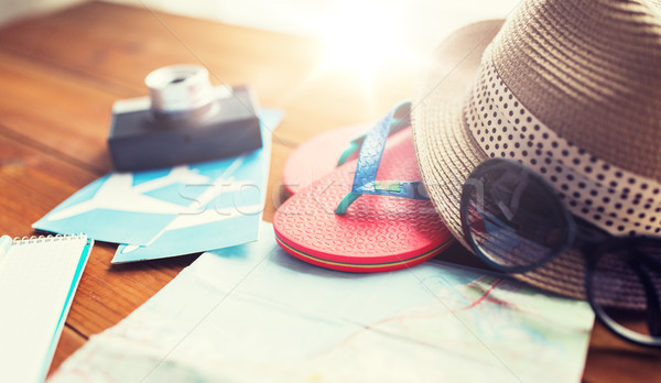 close up of travel map, flip-flops, hat and ticket Stock photo © dolgachov