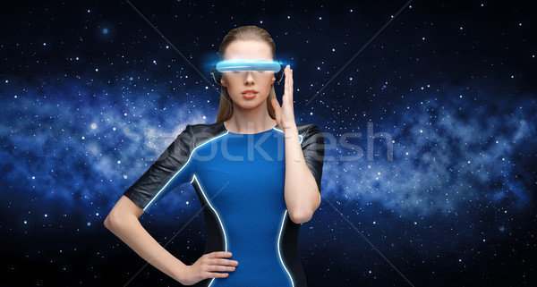 woman in virtual reality 3d glasses over black Stock photo © dolgachov