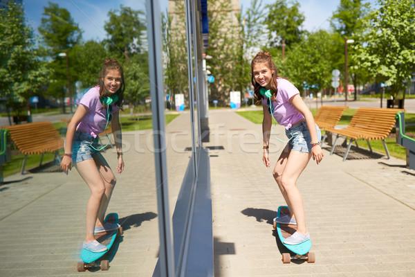 happy teenage girl riding on longboard in summer Stock photo © dolgachov