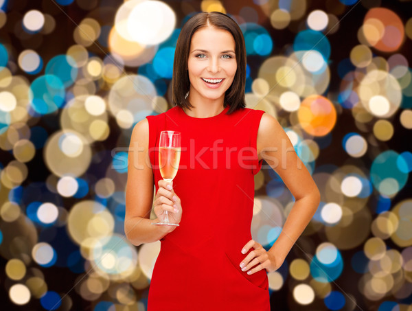 smiling woman holding glass of sparkling wine Stock photo © dolgachov