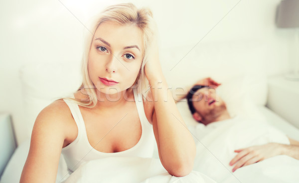 awake woman having insomnia in bed Stock photo © dolgachov