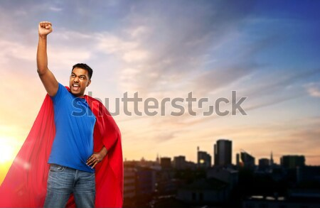 man in red superhero cape over city background Stock photo © dolgachov