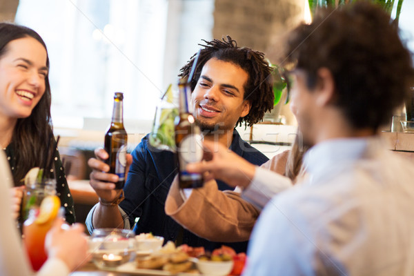 happy friends drinking non alcoholic beer at bar Stock photo © dolgachov