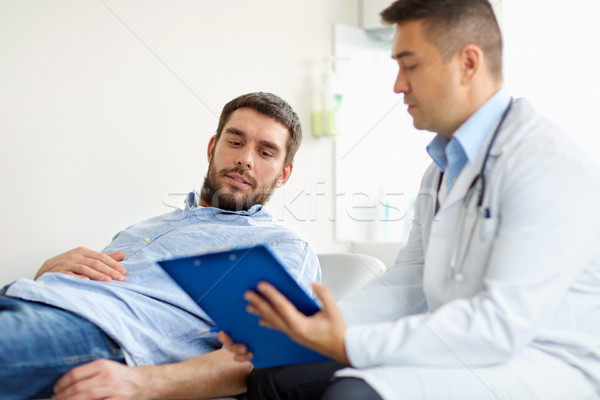 doctor and man with health problem at hospital Stock photo © dolgachov