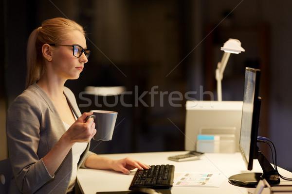 businesswoman at night office drinking coffee Stock photo © dolgachov