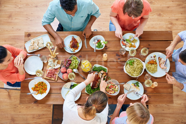 group of people eating chicken for dinner Stock photo © dolgachov