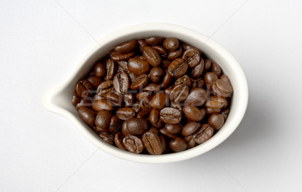 cup full of colombian coffee beans #2 Stock photo © dolgachov