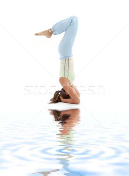 salamba sirsasana supported headstand on white sand #2 Stock photo © dolgachov