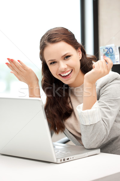 happy woman with laptop computer and euro cash money Stock photo © dolgachov