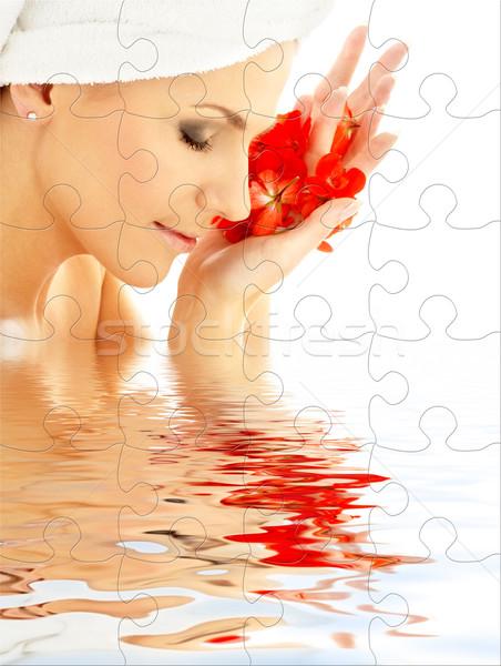 Hölgy piros szirmok víz puzzle nő Stock fotó © dolgachov