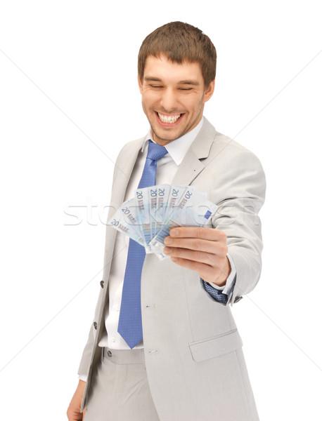 handsome man with euro cash money Stock photo © dolgachov