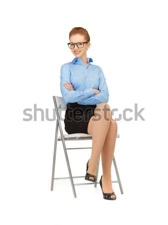 happy and smiling woman on a chair Stock photo © dolgachov